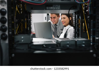 Two IT Engineers in Data Center, Server Room