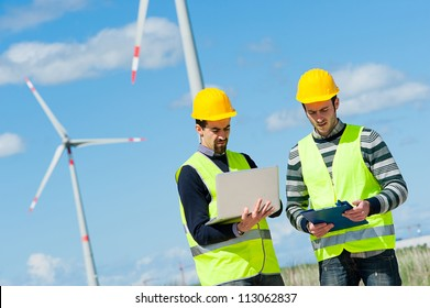 Two Engineers in a Wind Turbine Power Station, Italy
