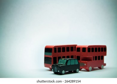 Two English buses and one cab