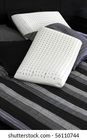 Two ergonomic pure latex pillows.