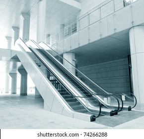 Two escalators in new modern building.