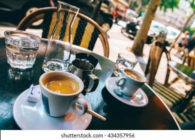 Two espressos at a Parisian cafe