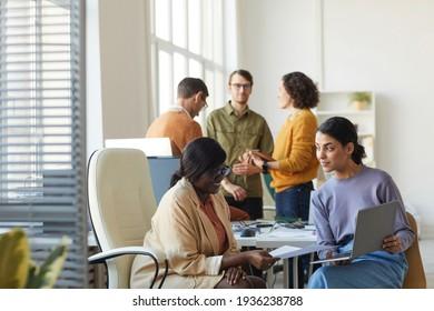 Two Ethnic Businesswomen Talking in Office