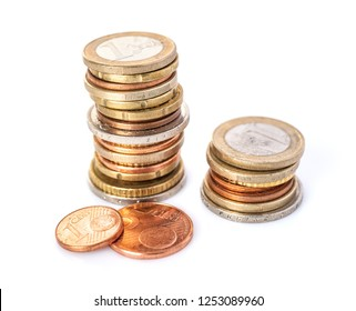 Two Euro coin stacks on a white background