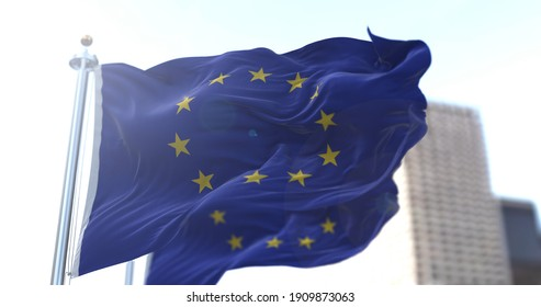 Two European flags flapping in the wind. European Union and Economic Community. Politics and Economy. Transnational political government