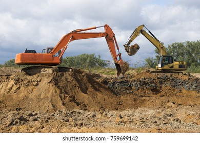 two excavators dig the ground