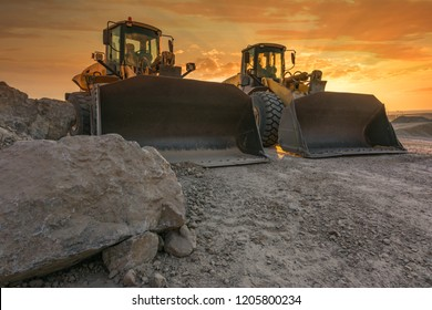 Two excavators removing stone in the construction works of a road