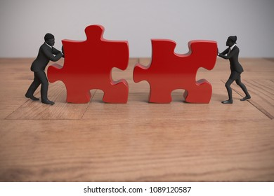 Two executive miniature people pushing jigsaw puzzle pieces into position on a wooden table demonstrate teamwork as 3d rendering.