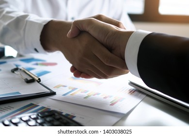 Two executives handshake as partners after the successful meeting.