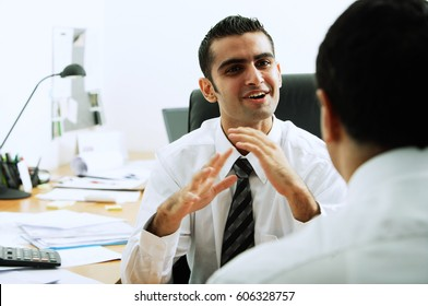 Two executives in office, talking face to face