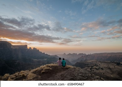 Two explorers enjoying the sunset after a day of difficult hiking, Simien Mountains, Ethiopia