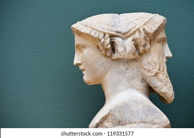 two faces of a person - historical sculpture