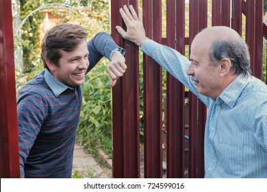 two farmers takling to each other on sunny day. They discuss important news