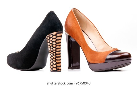 Two fashion women shoes over white