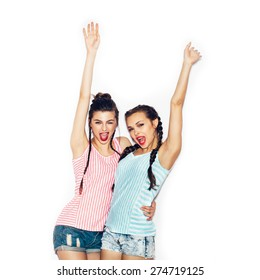 Two fashion young girl friends hugging and having fun. White background not isolated