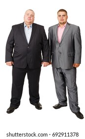 Two fat businessman. Two Businessman White Isolated. Studio portrait of two fat men in suits. Russian businessmen. Successful people in suits. Rich Russian. Fatties. Fat men.