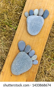 Two feet made with beach pebbles