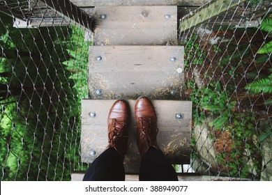 Two feet standing on a bridge in Vancouver, British Columbia.