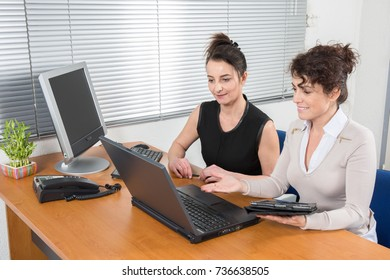 Two female colleagues Working women in the office