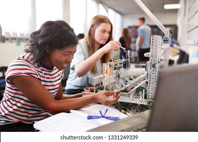 Two Female College Students Building Machine In Science Robotics Or Engineering Class - Shutterstock ID 1331249339