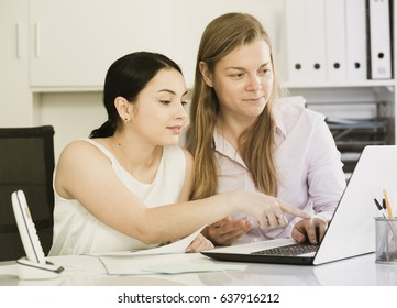 Two female employees having a productive day at work in office