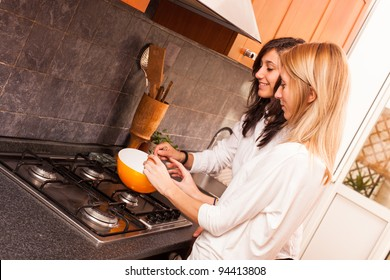 Two Female Friends Cooking in the Kitchen