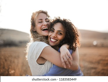 Two female friends having fun in summer.