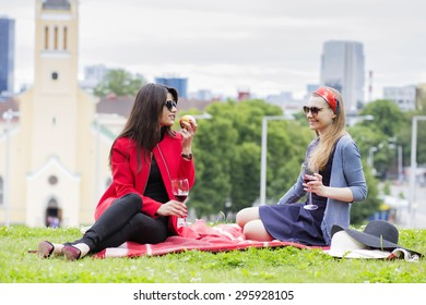 Two female friends on a picnic blanket