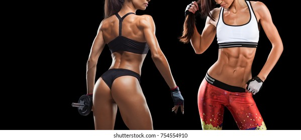 Two female friends taking a selfie photo after hard workout in gym.