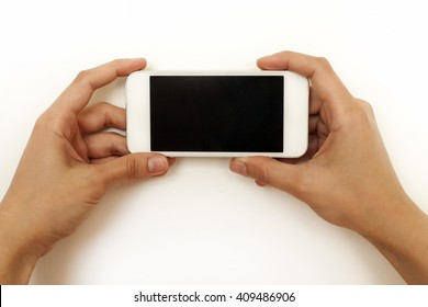 Two female hands holding mobile phone, smartphone, on white