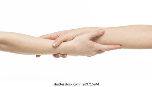 Two female hands holding on each other at the wrists, isolated on white