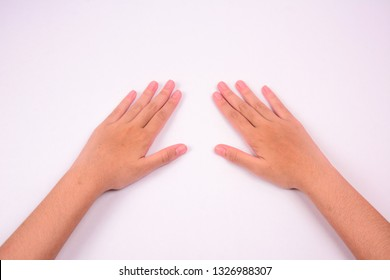 Two female hands with open palm facing down isolated against white background.