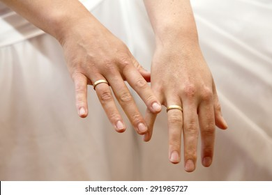two female hands show their wedding rings