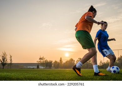 two female soccer players on the field