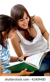 Two female students studying isolated over white