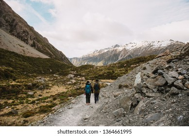 Two female trekking along the Hooker Valley Track in Mount Cook National Park.