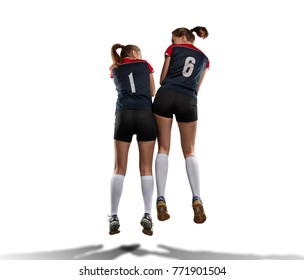 two female volleyball players celebrating point