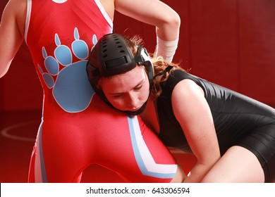 Two female wrestlers practicing