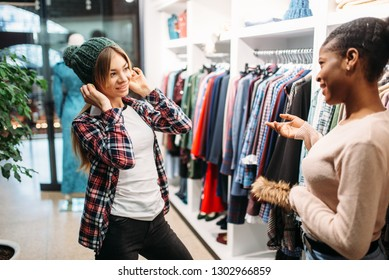 Two females buying clothes in shop, shopping