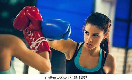 Two Females Sparring At Gym