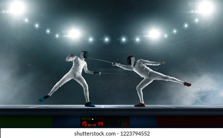Two fencers on professional sports arena