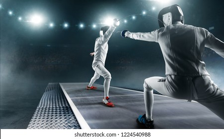 Two fencing athletes fight on professional sports arena