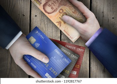 Two fiat currency bills being exchanged by two business people as part of a business transaction.
