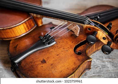 two fiddles on a wooden, rustic background