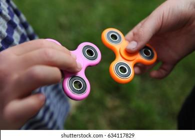 Two fidget spinners