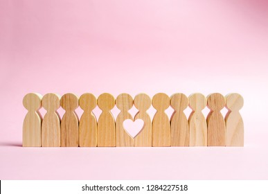 Two figures of people in a row form a void in the shape of a heart. Concept of love and search for the second half. Find a soul mate and start a family. Love and romance, real secret feelings