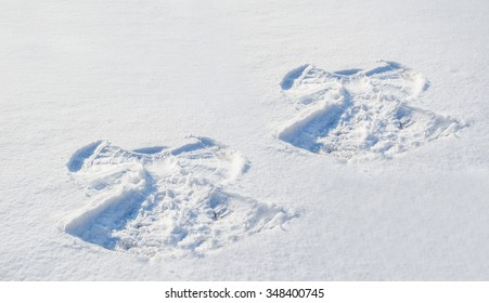 Two figures in the snow angel.