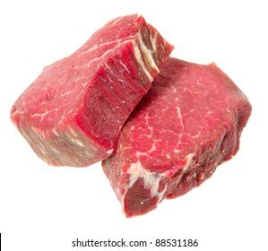 two filet mignon steaks, cut from beef tenderloin, isolated on a white background.