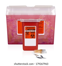 Two Filled Sharps Containers. The full, large transparent container, contrast with smaller container.