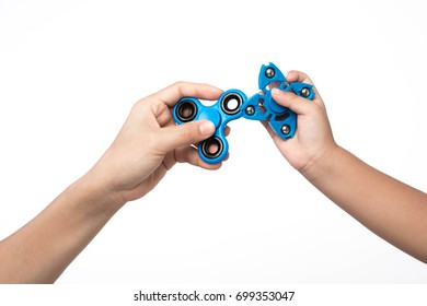 Two finger spinner stress, anxiety relief toy on white background.